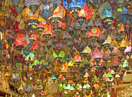 Ornate glass lights hanging in market stall at a souk