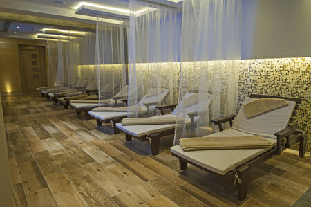 Relaxation area insode a luxury health spa with beds and towels