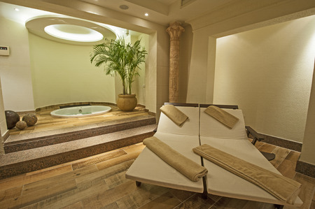 Beds and jacuzzi in a private VIP area of luxury health spa