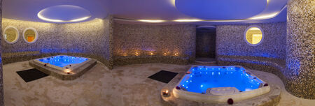 Panoramic view of wet area in a luxury health spa with two large jacuzzi