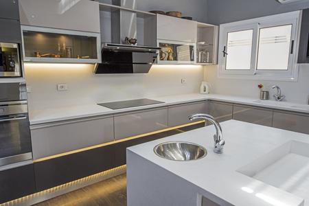 Foto de Interior design decor showing modern kitchen with cupboards in luxury apartment showroom - Imagen libre de derechos