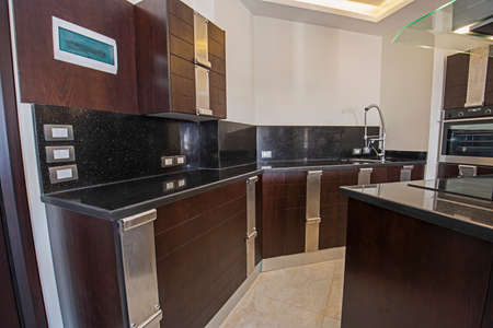 Photo pour Interior design decor showing modern kitchen with cupboards in luxury apartment showroom - image libre de droit