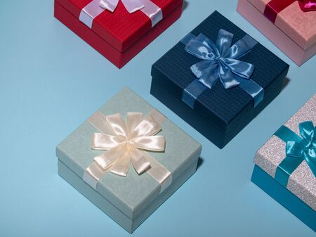 Photo for Different colored gift box on pastel blue background. Top view of various present boxes. Birthday, Christmas, wedding, valentine, romantic gifts - Royalty Free Image