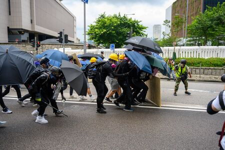 Photo for Hong Kong - Aug 31, 2019: Protest against extradition law in Hong Kong turned into another police conflict. Police use tear gas against protestors. - Royalty Free Image