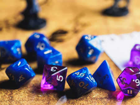 Foto de Roleplay game with dragons in dungeon. Yellow field dice. - Imagen libre de derechos