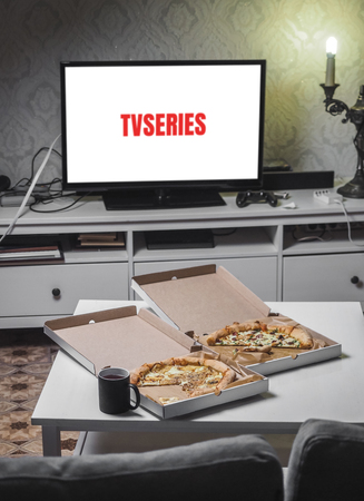 Foto de Pizza in delivey box with TV series in living room. - Imagen libre de derechos