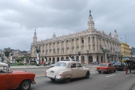 Havana Cuba - 26 January 2018: Gran Teatro de La Habana- Great Theater of Havana with Classic cars in foreground
