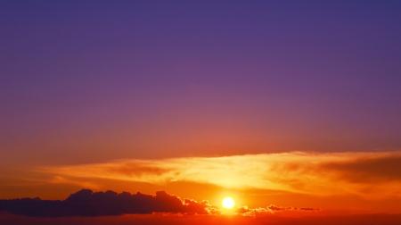 bright orange sunset and violet sky