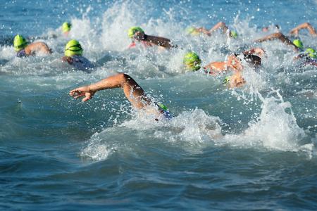 Photo pour Group people in wetsuit swimming at triathlon - image libre de droit