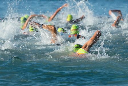 Photo pour Group people in swimming at triathlon wetsuit - image libre de droit