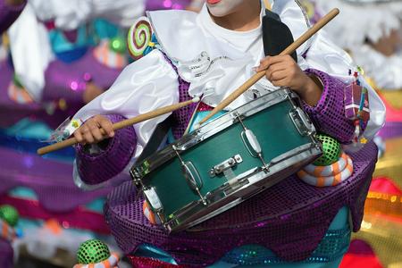 Boy drumming at carnival