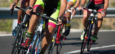 Photo pour Cycling competition,cyclist athletes riding a race at high speed - image libre de droit