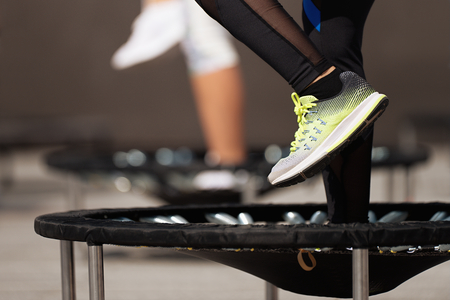 Photo for Fitness women jumping on small trampolines,exercise on rebounder - Royalty Free Image