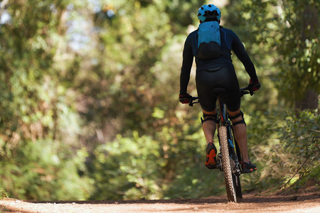 Photo for Mountain biking man riding on bike in summer mountains forest landscape - Royalty Free Image