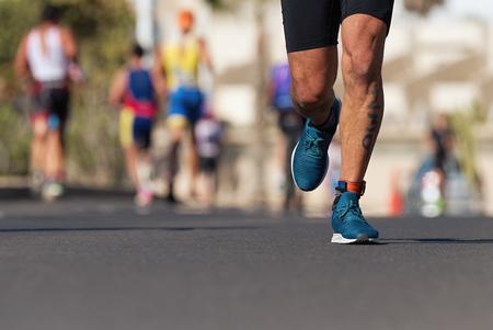 Foto de Marathon competition during an ironman the numbers on the leg - Imagen libre de derechos