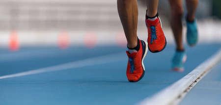 Foto de Athletes sprinters run speed on track of stadium - Imagen libre de derechos