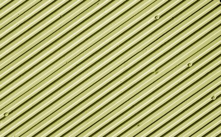 Photo pour Metal plate wall in yellow tone. Abstract architectural background and texture for design. - image libre de droit