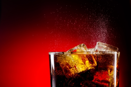 Ice cola with splashing CO2 bubbles