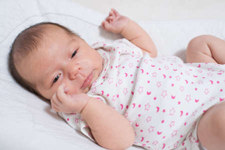 Photo pour Cute, small and adorable newborn baby girl - image libre de droit