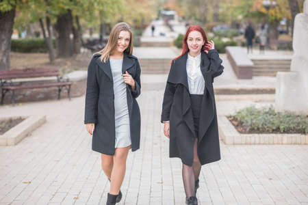 Photo for Two cute young girls are walking and talking about important topics - Royalty Free Image