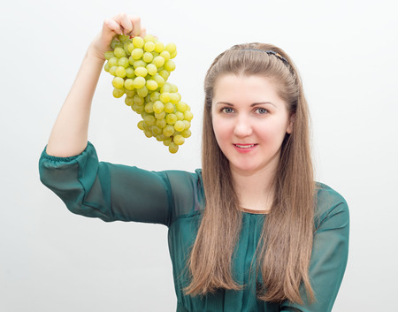 Portrait of a pretty girl with grapes