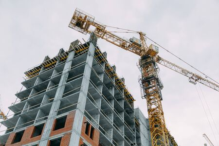 Photo for Construction of modern high-rise buildings. Phased construction of structures in winter. - Royalty Free Image