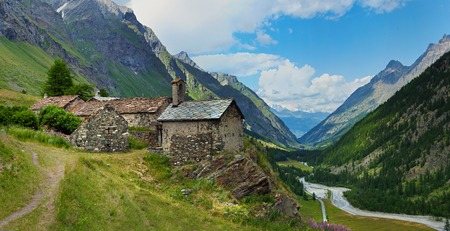 alpine old architecture with mountain river in Rhemes, Notre Dame