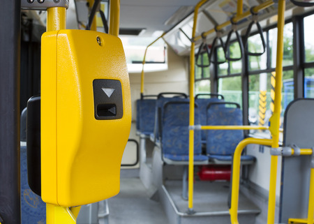 Photo pour Yellow ticket validation machine on a modern public transport bus - image libre de droit