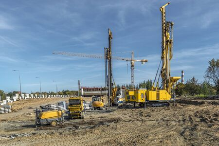 Pile driving drilling machines working on road construction. Road building with drilling machine. Drilling machine ready to drill piles on a road building site