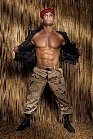 Muscular handsome soldier posing, perfect body.