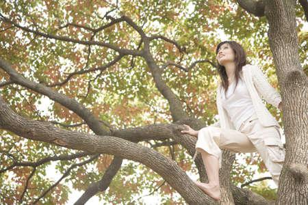 Woman whom the tree climbs