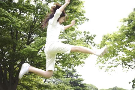 Japanese woman jumpingの写真素材