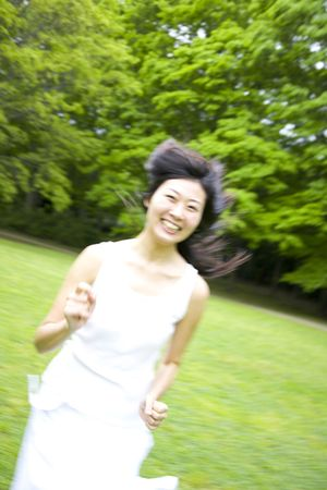 Japanese woman running in the park
