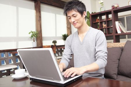 Japanese man operating a PC