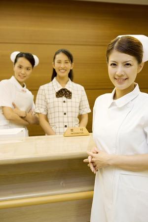Hospital reception women and nurses
