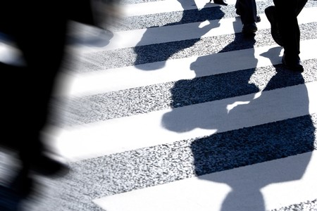 Businessman's silhouettes on the crosswalk