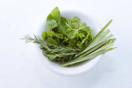 Several kinds of herbs in the white cup