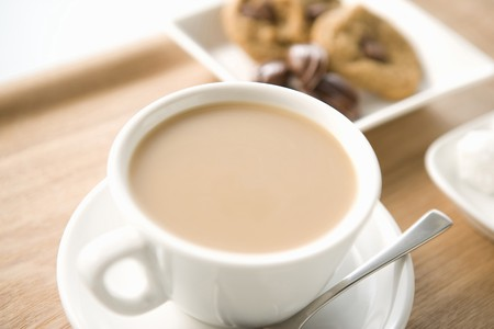 Cafe au lait and cookies on the wooden tray