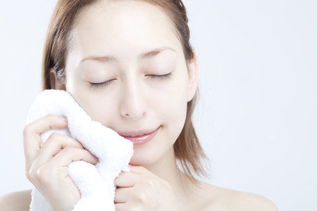 Women wipe the face with a towelの写真素材