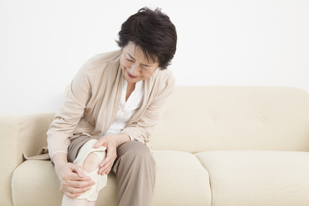 Senior woman suffering from joint pain