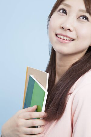 Smiling female students have a text