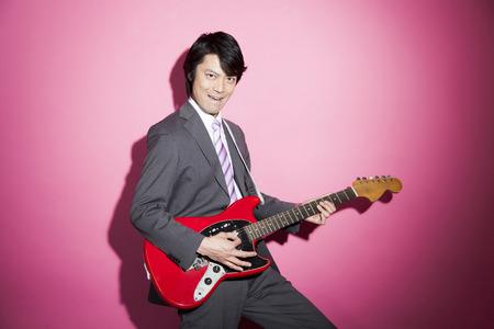 Businessmen play guitar