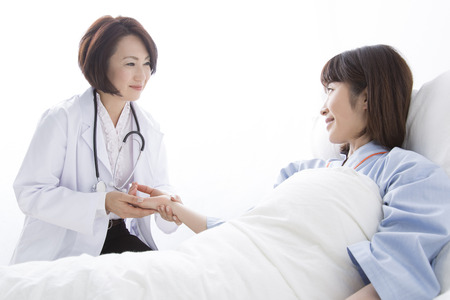 Female doctor and the patient to take the pulse
