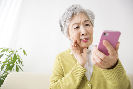 Senior women working with smart phones
