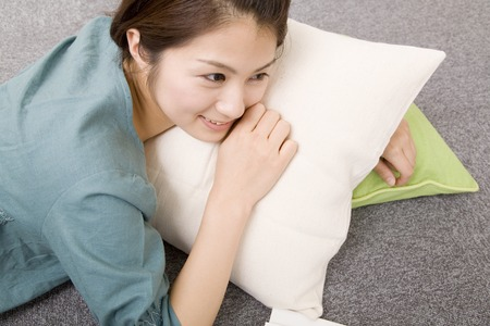 Woman to be leaning against the cushion
