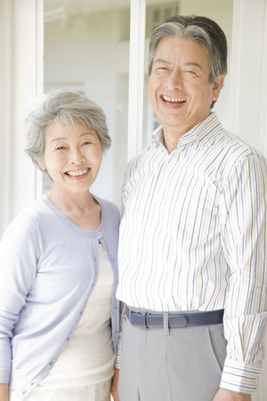 An elderly couple have to laughの写真素材