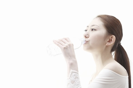 Woman drinking waterの写真素材