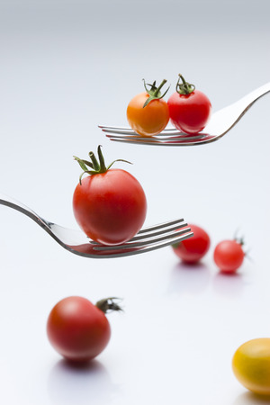 On the fork of cherry tomato
