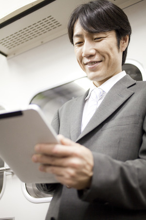 Businessmen working with Tablet PC