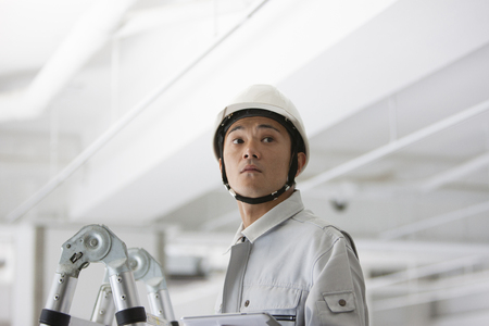 Male workers to use a Tablet PC